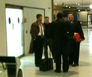 John Faso, Wilzig employee Erik Tyree, James Walsh and John Ciampoli huddle after a hearing before the 3rd Judicial Department